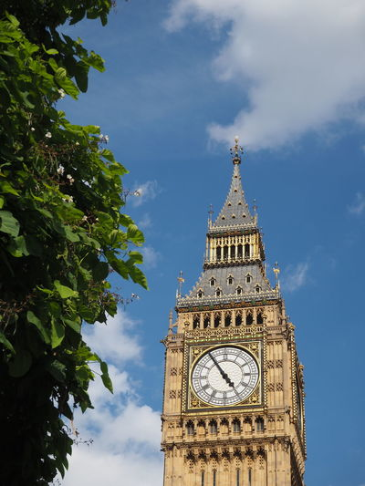 Big Ben Architecture Big Ben Big Ben, London Building Building Exterior Built Structure Clock Clock Face Clock Tower Cloud - Sky Clouds Clouds And Sky Cloudy EyeEm LOST IN London History Leaves Low Angle View Sky Tall Tall - High Time Tower Travel Destinations Tree Postcode Postcards