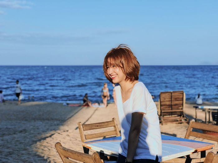 Smile under sky Potrait EyeEm Selects Sea Beach Water One Person Horizon Over Water Casual Clothing Real People Sky People The Modern Professional