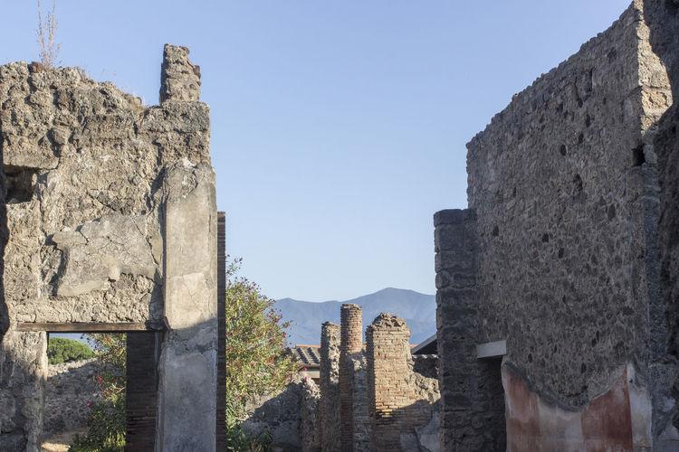 Low angle view of old ruin against sky