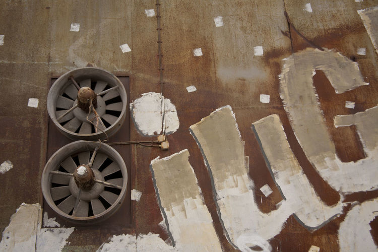Low angle view of exhaust fans on wall