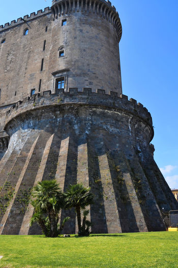 The New Castle (House of Anjou) in Naples, Italy. Castel Nuovo (Maschio Angioino) di Napoli. Ancient Ancient Civilization Architecture Architecture Blue Building Exterior Built Structure Castle Clear Sky Eye4photography  Famous Place Historic Historical Building History International Landmark Low Angle View Old Old Ruin Sky The Past Tourism Travel Travel Destinations Travel Photography Traveling