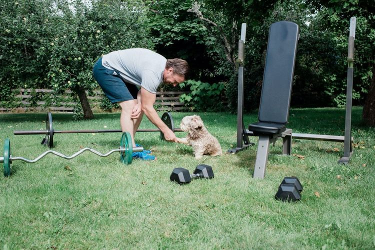 Man with dog in yard