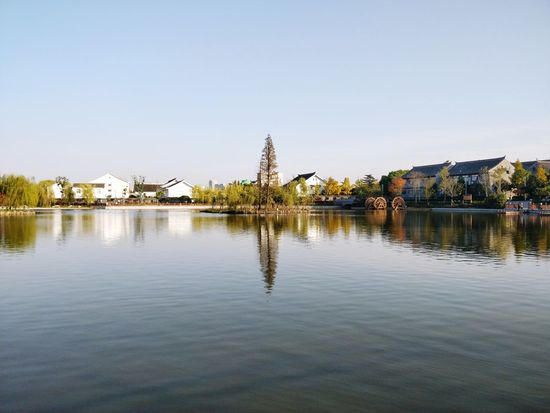 Reflection Outdoors Sky Lake Travel Destinations Water Clear Sky Cityscape City Tree Nature Day Park