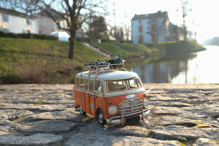 Building Exterior Focus On Foreground Architecture Built Structure Day Transportation Toy Mode Of Transportation Toy Car Nature Outdoors Car Retro Styled Building No People City Tree Close-up