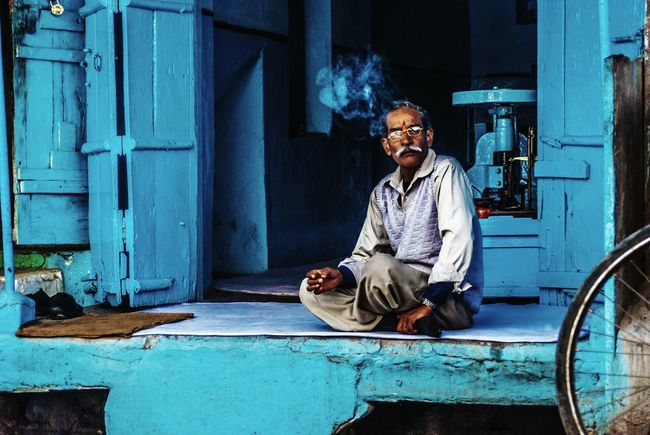 In the Blue. Sitting One Man Only One Person Senior Adult Blue Only Men One Senior Man Only Adults Only Mature Adult Portrait People Adult Outdoors Eyeglasses  Real People Men Day Shop Shopkeeper Alwar Blues EyEmNewHere Intheblue Tones Gameoftones