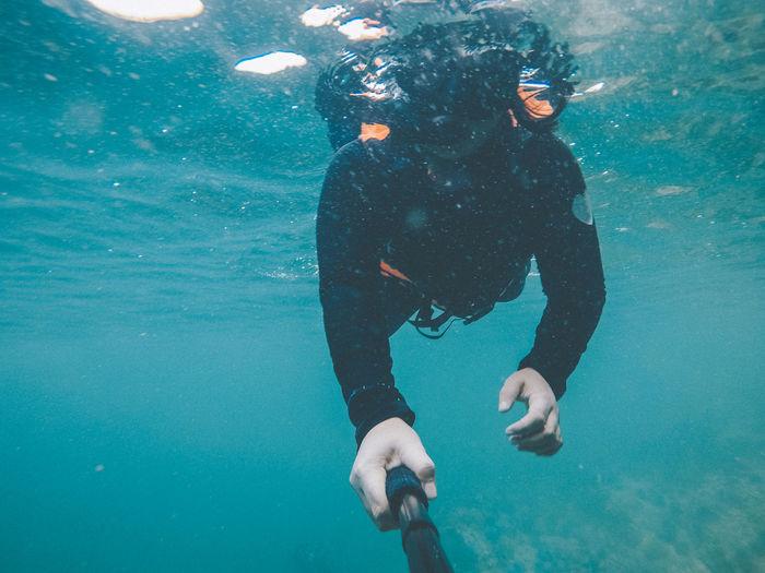 Woman swimming in undersea