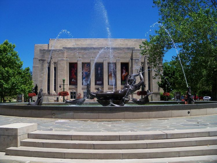 The IU Auditorium Fountain Architectural Column Architecture Architecture Blue Building Building Exterior Built Structure City Day Façade Fountain Indiana University IU Auditorium Mermaid Outdoors Sculpture Sky Stone Steps Sunlight Sunny Travel Destinations The Color Of School Trees Water Waterdrops Adventures In The City The Traveler - 2018 EyeEm Awards The Great Outdoors - 2018 EyeEm Awards