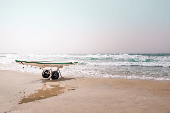 Mediterranean Sea Reflection Sunlight Absence Beach Beauty In Nature Copy Space Horizon Over Water Leisure Activity Lifestyles No People Paddle Paddleboard Rack Sand Scenics - Nature Sea Sky Sports Activity Surfing Tranquil Scene Tranquility Water Waterfront Wave