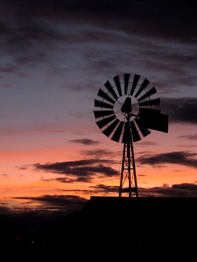 Windmill in the evening Evening Windmill Farm Sky Cloud - Sky Silhouette Sunset Fuel And Power Generation Environmental Conservation Environment Nature Renewable Energy Beauty In Nature Scenics - Nature Alternative Energy Wind Power Wind Turbine Outdoors Rural Scene