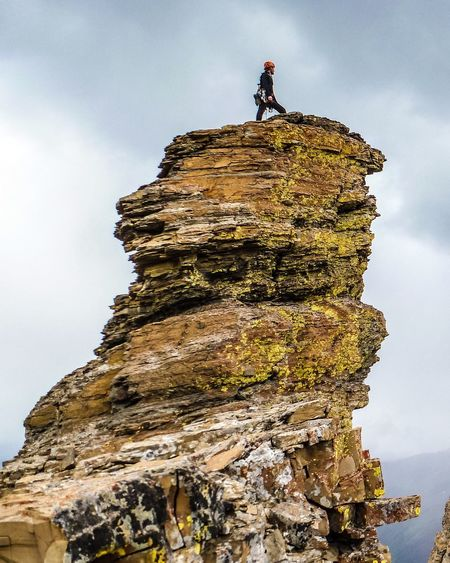 Low Angle View Of Man On Cliff