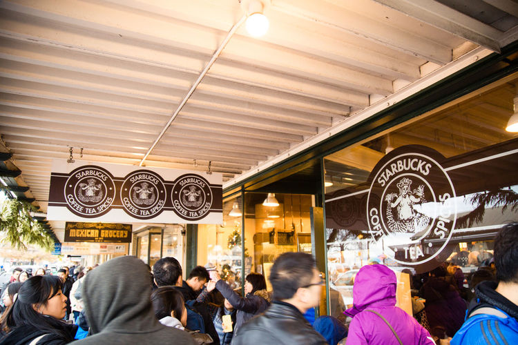 The not so original, 'original Starbucks' in downtown Seattle. Cafe City City Life Coffee Coffee Tea Spices Crowd Day Illuminated Large Group Of People Original Starbucks Pike Place Pike Place Market Real People Seattle Spices Starbucks Tea Tourism Tourist Attraction  Tourists Travel Travel Destinations Traveling Vintage Starbucks Washington