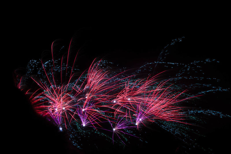 Arts Culture And Entertainment Black Background Blurred Motion Celebration Dark Event Firework Firework - Man Made Object Firework Display Glowing Illuminated Light Light - Natural Phenomenon Long Exposure Low Angle View Motion Multi Colored Nature Night No People Sky Sparks