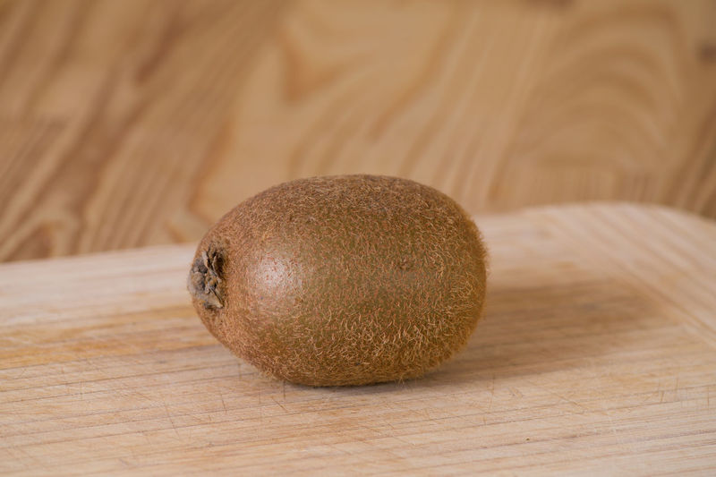 Close-Up Of Kiwi Fruit On Cutting Board