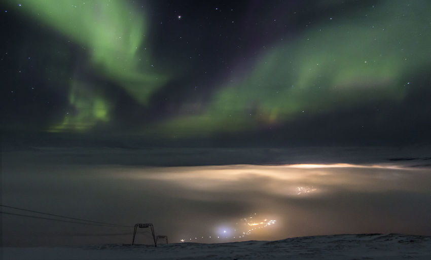 Scenic view of dramatic sky at night during winter