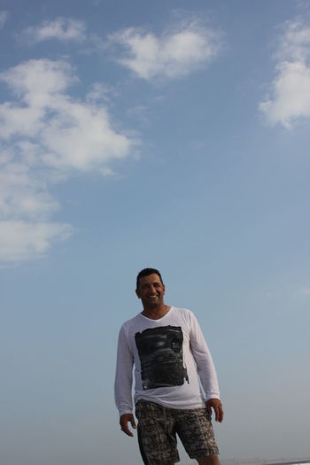 Standing Sky Cloud - Sky One Person Front View Casual Clothing Lifestyles Real People Young Men Day Adult Nature Smiling Outdoors Men White Teeth Oman Oman_photo Duqm Couds And Sky Blue Sky