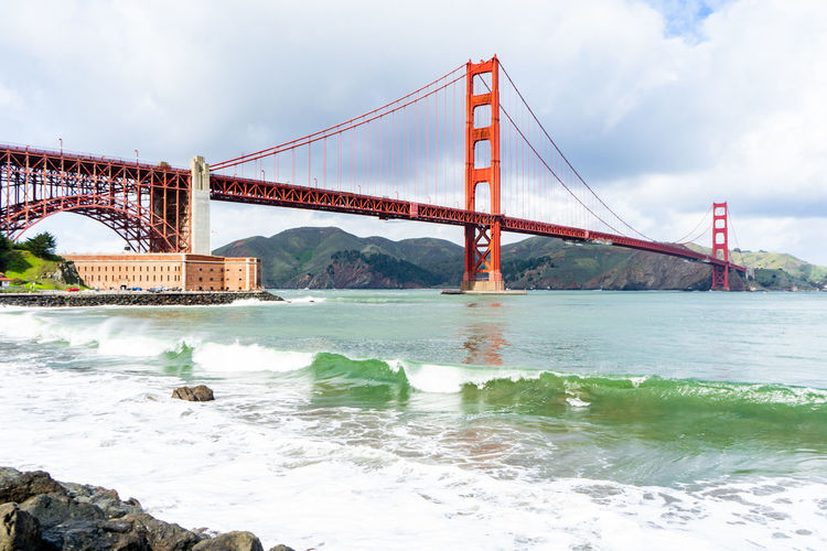 Water Bridge Bridge - Man Made Structure Built Structure Architecture Connection Transportation Sky Suspension Bridge Travel Destinations Nature Engineering Cloud - Sky Travel Bay City Bay Of Water Day Tourism Outdoors