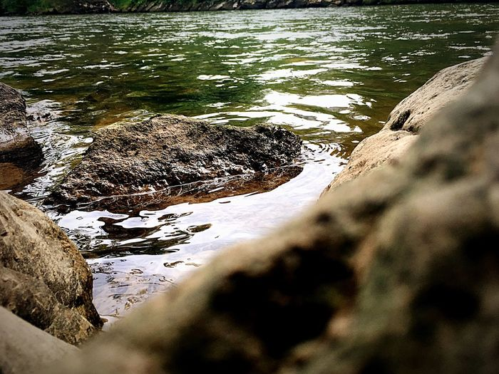 View of rocks with rippled water