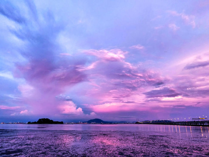 Purplish sun set view. Malaysia Penang Island Sunset Purplish Water Sea Sunset Multi Colored Beach Purple Dramatic Sky Sky Cloud - Sky Horizon Over Water Magenta Romantic Sky Lightning Moody Sky Power In Nature Cloudscape Atmospheric Mood Calm