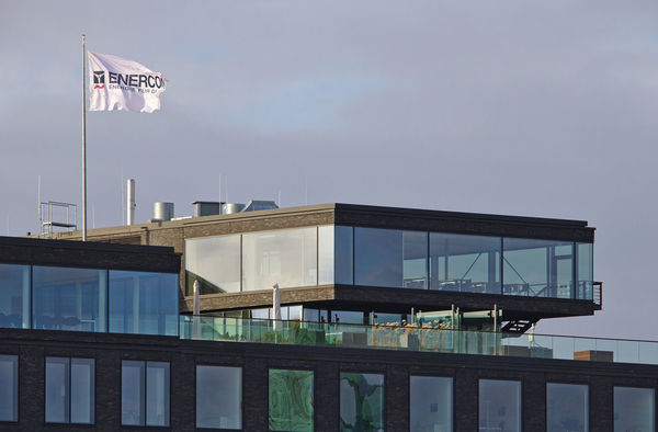 Penthouse on top of former headquarters building of bankrupt Beluga shipping company with flag of Enercon wind power company flying on the roof City Enercon Penthouse Wind Energy Wind Power Architecture Beluga Building Exterior Built Structure Day Flag Glass Headquarters Nils Stolberg No People Outdoors Renewable Energy Sky Urban Water
