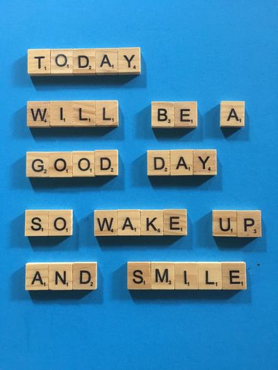 Directly above shot of text on wooden blocks against blue background