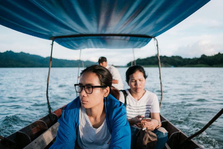 Women sitting in boat on sea