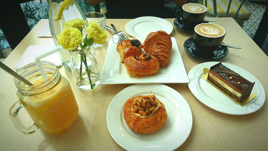 Visual Feast. British High Tea Croissant Chocolat Gâteaux Walnutpie Blueberry Pie Mango And Passion Fruit Ice Blended Hot Latte Yummylicious Indulgence Dessert Visual Feast Visual Feast