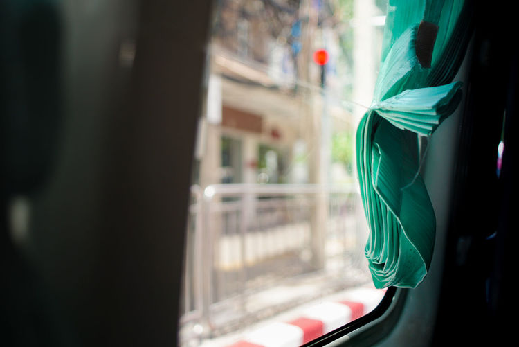 Close-up of curtain in vehicle