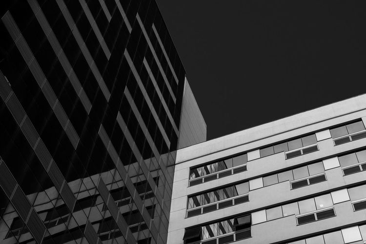 Architecture Building Exterior Low Angle View Built Structure Communication City Outdoors Day No People Skyscraper Sky Black & White Black And White Blackandwhite City Apartment Window Architecture