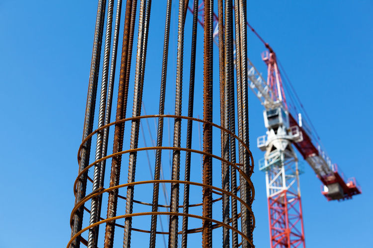 Steel reinforcement. Building crane. Building Infrastructure Architecture Business Construction Copy Space Industry Crane House Investment Material Materials Preparation  Reinforcement Site Sky Steel Technology