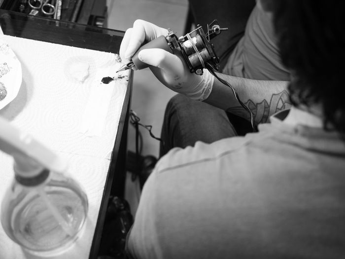 Black And White Craftsman Design Drawing Hands Indoors  Ink Tattoo Tattoo Shop Tools Working
