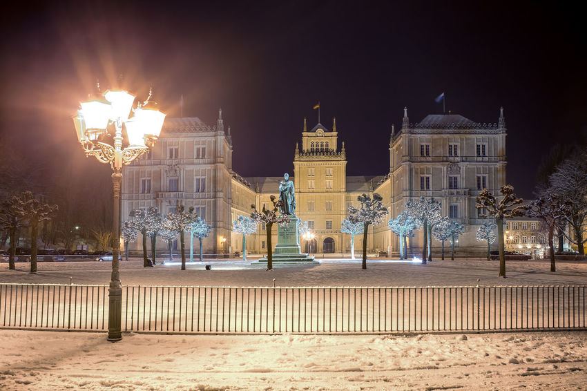 Wintry view of Ehrenburg palace at night in Coburg, Germany Ehrenburg Palace, Lamp, Architecture, Building, Church, Cities, Coburg, Culture, Destinations, Europe, European, Germany, House, Light, Lighting, Night, Snow, Street, Travel, Winter, Wintry, Architecture Building Exterior Built Structure Illuminated Night No People Outdoors Sky Travel Destinations Tree