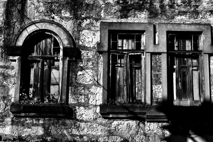old Portugalbnw Bnw_of_our_world Bnw_globe Bnwsouls Bnw_city Bnw_of_the_world Bnw_captures Bnwphotography Blackandwhitephotography Bnw Photowall_bnw Bnw_mood Bnw_top Bnwpics Bnw_magazine Igersportugal Built Structure Architecture Window Building Building Exterior No People Day Old Abandoned Weathered The Past History Low Angle View Damaged