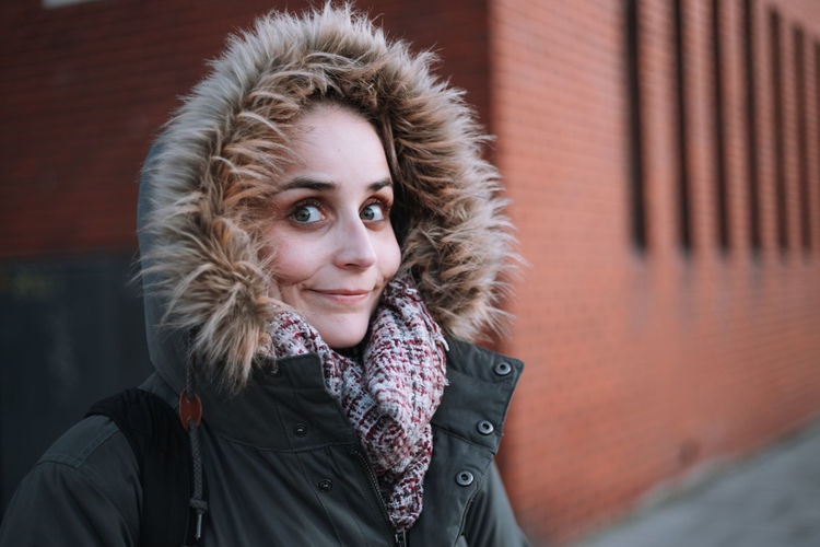 Portrait of beautiful young woman in warm clothing during winter