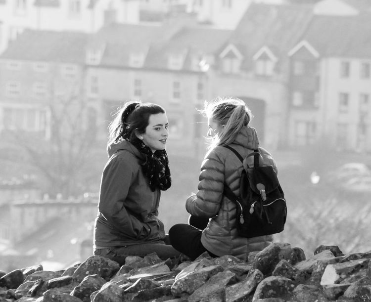 Street Photography Streetlife Black And White Monochrome Photography Candid Evening Sun Young Women Females People Stone Wall Sitting Outside Highlights Picsartrefugees The Street Photographer - 2016 EyeEm Awards Black And White Friday