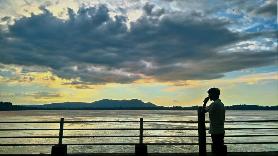 Shadow Cloud - Sky Water Mountain Sky Sunset One Person Outdoors Mountain Range Nature Sea People Standing Scenics Beauty In Nature Travel Destinations Landscape Day Beach Adult Children Only