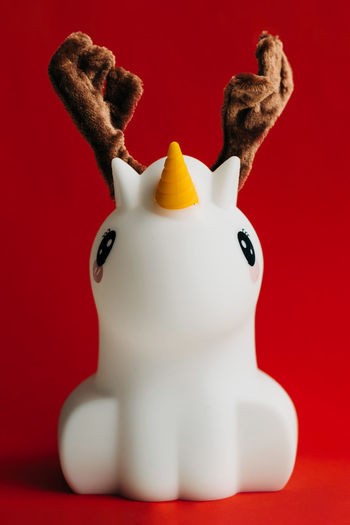 Close-up of stuffed toy against red background