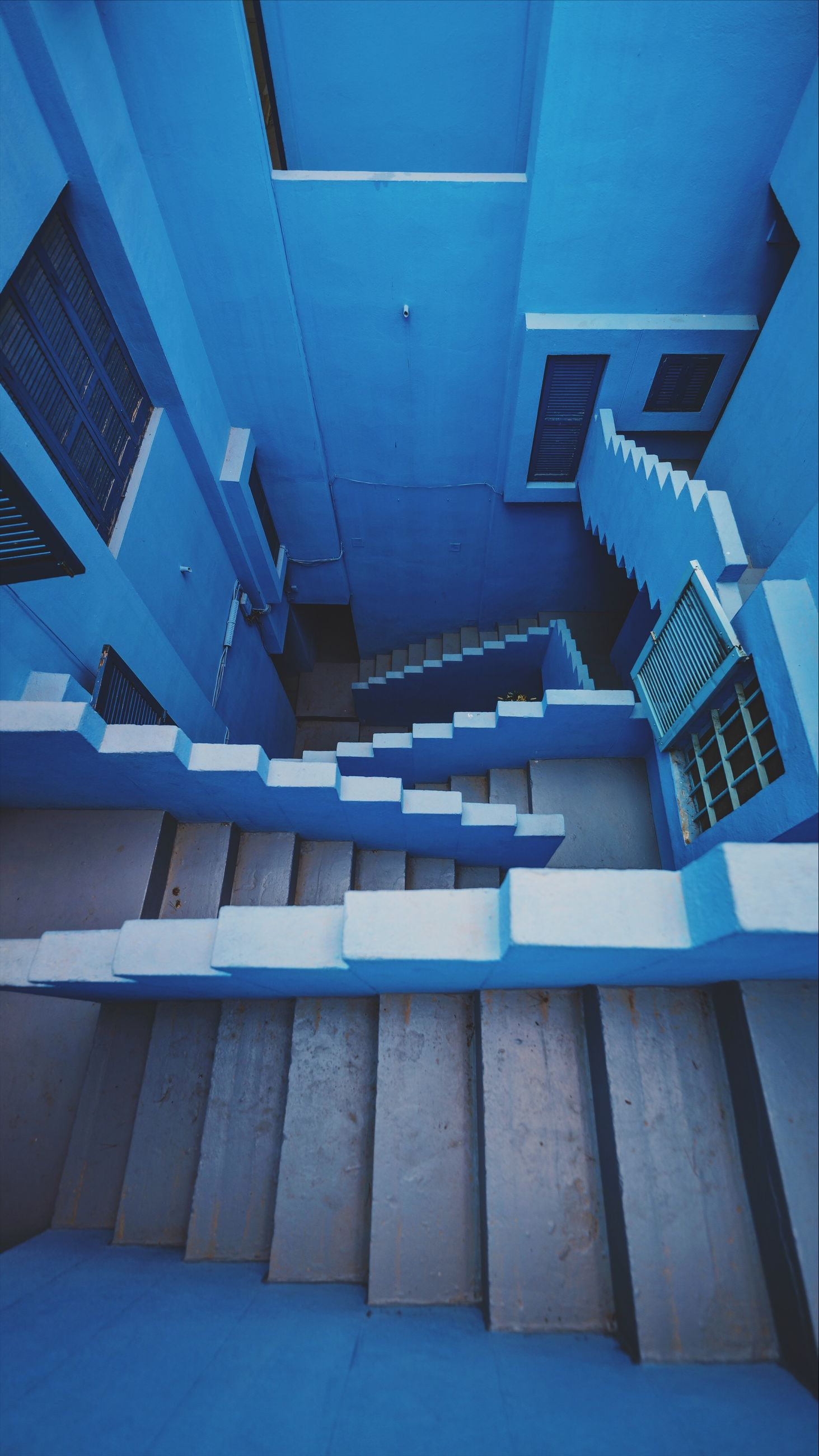 architecture, built structure, building, no people, staircase, steps and staircases, indoors, day, railing, blue, low angle view, empty, pattern, absence, residential district, nature, window, ceiling