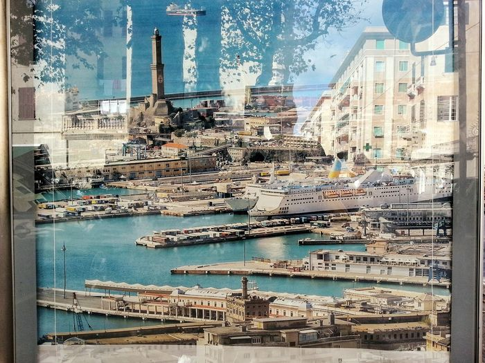 Genoa inner Harbour and Lanterna Di Genova in a Photo Of A Photo / Billboard Cartellone Reflecting Surface Day Outdoors Cityscape City Sky Cruise Ships Smartphone Photography Note 2 Android Photography Full Frame Reflections Trees No People Buildings