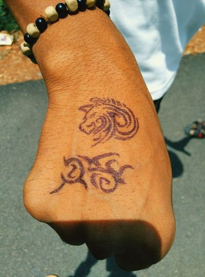 South i sketched the tatoo is my friend hand using cd marker pen