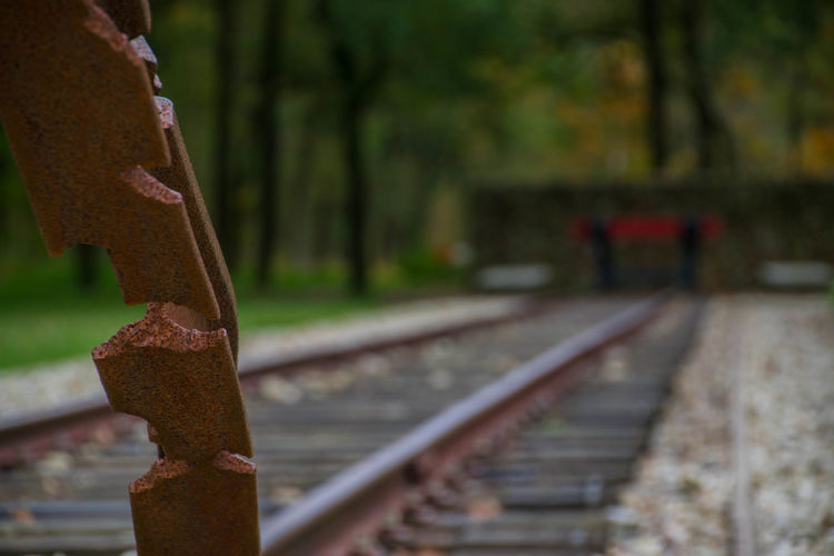 Close-up of rusty metal by railroad track