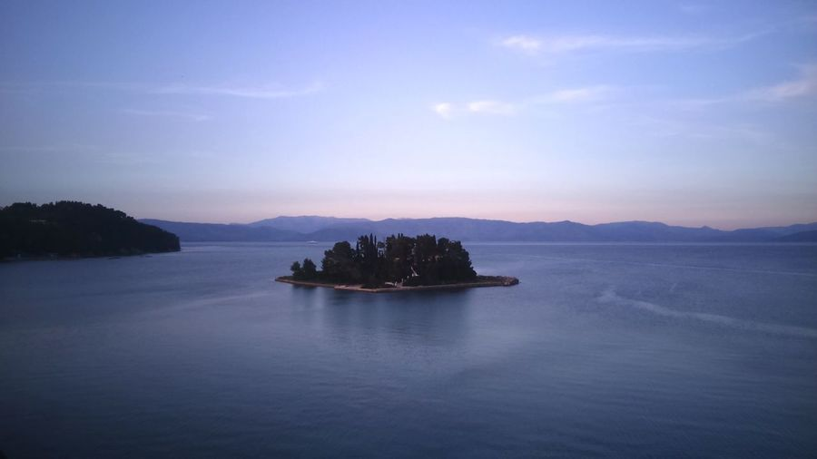 Mouse Island EyeEmNewHere Tree Trees And Sky Colours Calmness Corfu Nature Beauty Greece Mouse Island Sea Water Scenics Nature Sky Mountain Beauty In Nature No People Tranquil Scene Outdoors Tranquility Sunset Nautical Vessel Architecture Tree Day EyeEmNewHere