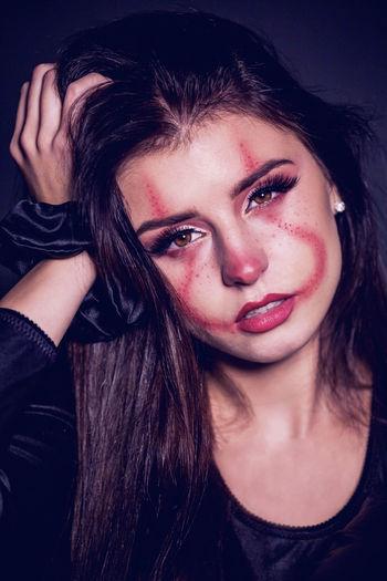 Portrait of beautiful young woman wearing make-up