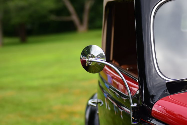 Close-Up Of Side-View Mirror In Vintage Car
