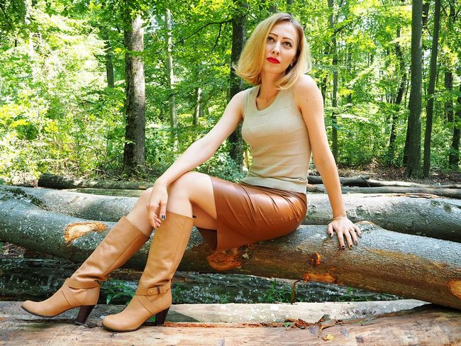 Young Woman Beauty Portrait Beautiful People Beautiful Woman Blond Hair Leather Skirt  Boots Lifestyle The Week On EyeEm EyeEmNewHere Blonde Woman Fashionista Fashion&love&beauty Summer Casual Clothing Fashion Model Fashion Forest Tree Trunks Middle Aged Woman Makeup Woman Portrait Female Portrait Tree Trunk