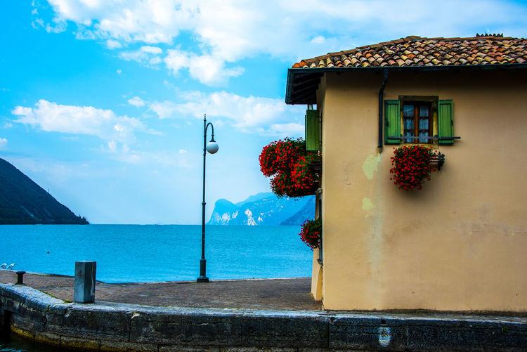 House by sea against sky