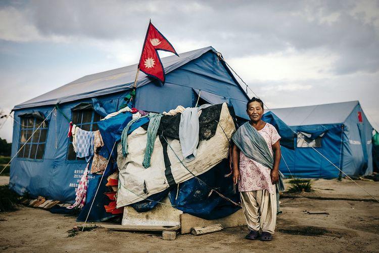 Nepalese refugee beside the national flag. EyeEm Masterclass EyeEm Best Shots Documentary Photography Portrait Photography Kathmandu, Nepal Picturing Individuality The Photojournalist - 2015 EyeEm Awards