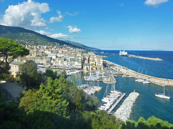Bastia. Corsica. Old port. Sea High Angle View Water Architecture No People Cityscape Outdoors Sky Nautical Vessel Blue Cloud - Sky City Day Built Structure Tree Horizon Over Water Harbor Nature Vacation Travel Corsica Bastia Old Port Boat Sailing Boat ferry. Mountain. Blue. Copy space.