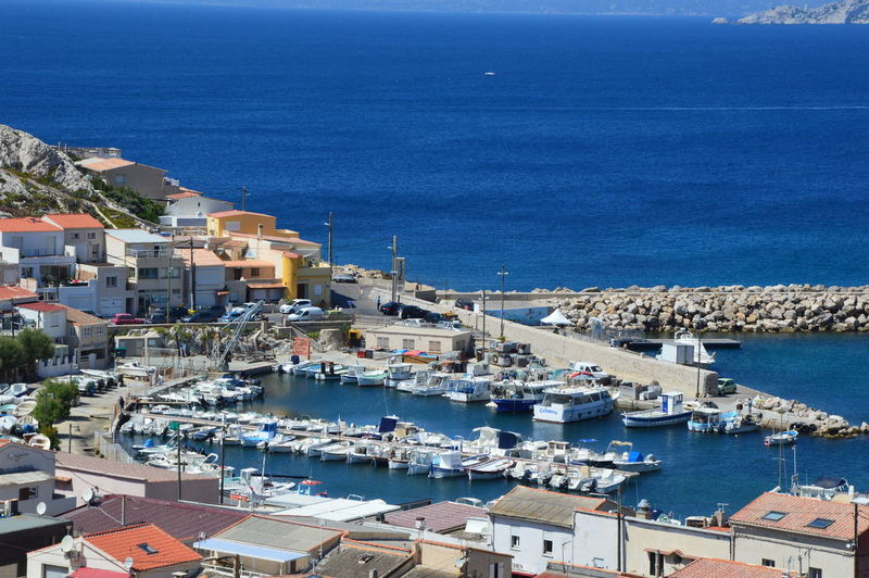 High angle view of townscape by sea against sky