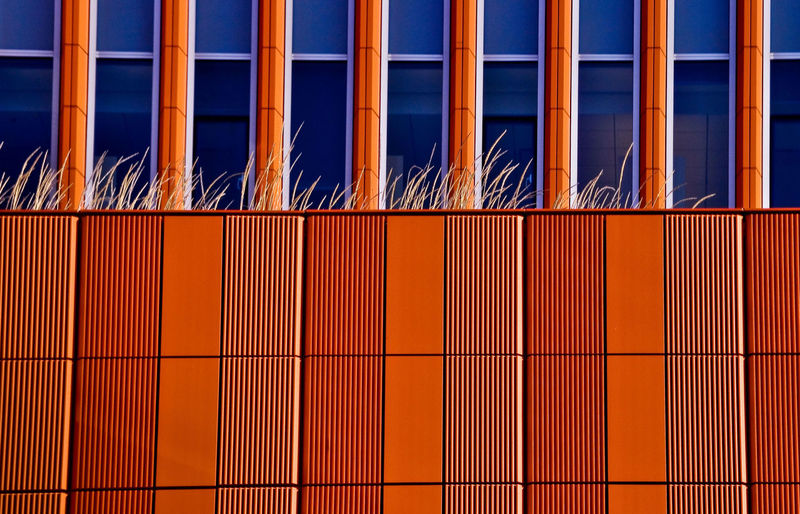 Architecture Backgrounds Blue Brown Building Story Built Structure City Life Close-up Conformity Day Full Frame Modern Multi Colored No People Orange Color Reflection Repetition