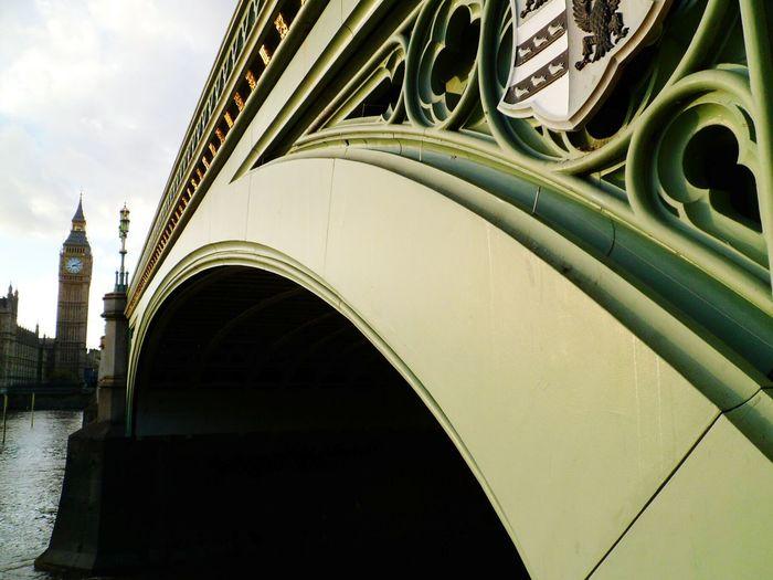 Close-up of westminster bridge over thames river by big ben